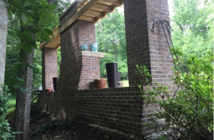 Back side of brick outdoor kitchen