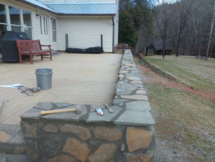 Wood deck with rock wall exterior
